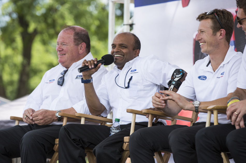 Raj Nair, flanked by Chip Ganassi and Ryan Briscoe, discusses Ford's victory at Le Mans.